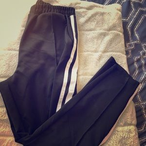 Garage black track pants with white stripes